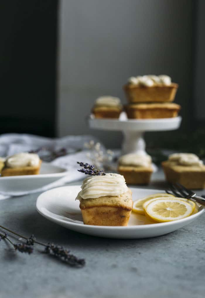 Mini Loaf Cakes made with olive oil, lemon and lavender and topped with a light ricotta mascarpone icing | thealmondeater.com