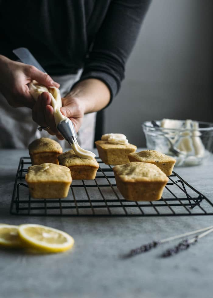 Mini Loaf Cakes made with olive oil, lemon and lavender and topped with a light ricotta mascarpone icing!