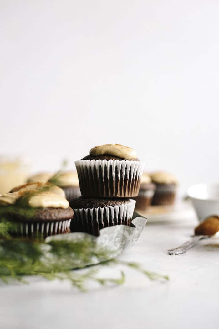 Vegan Espresso Cupcakes topped with a cinnamon tahini icing that you MUST try!   thealmondeater.com