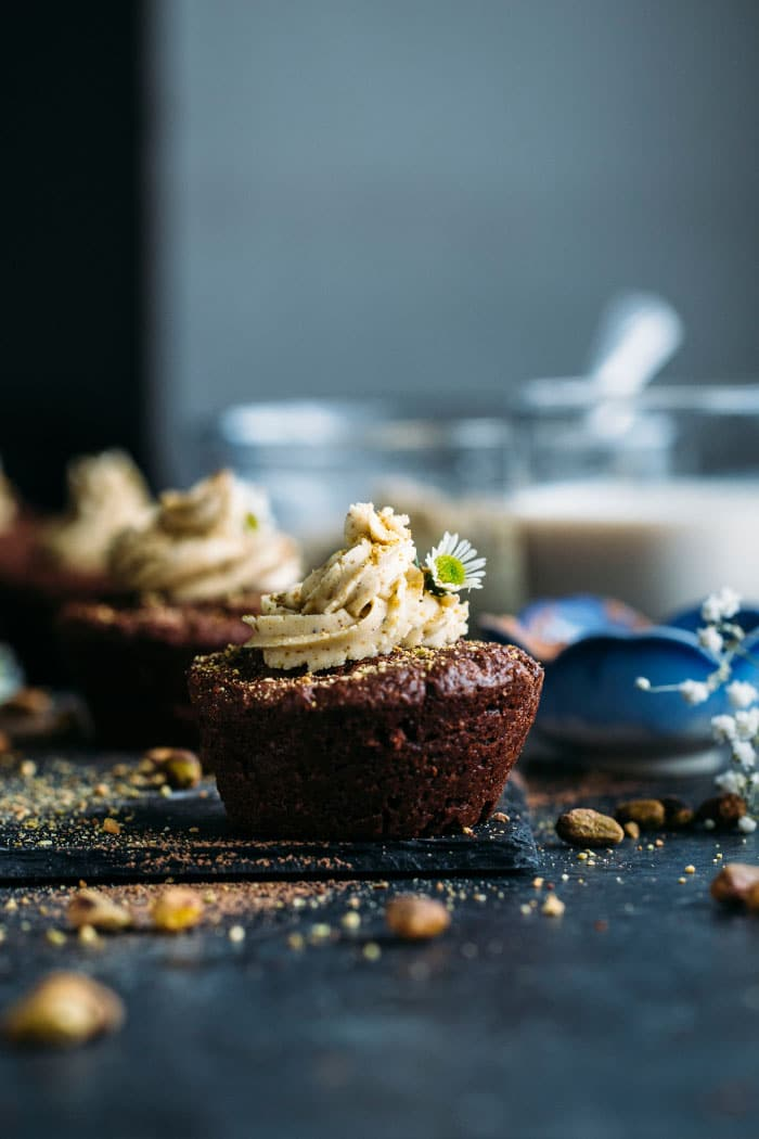 Brownie Cupcakes--taste like brownies, look like cupcakes and are topped with a salty-sweet pistachio icing!