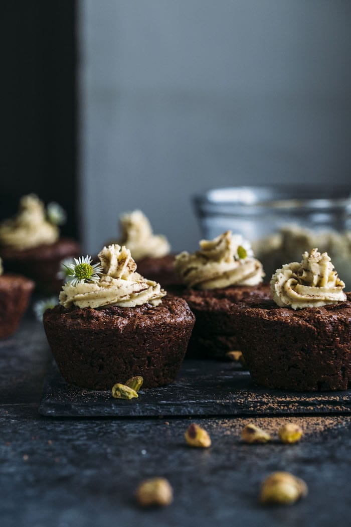 Brownie Cupcakes: they look like cupcakes, taste like brownies are are topped with a salty-sweet pistachio icing!