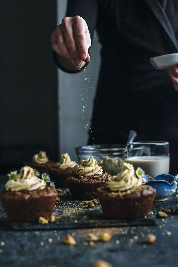 brownie cupcakes with pistachio icing | thealmondeater.com