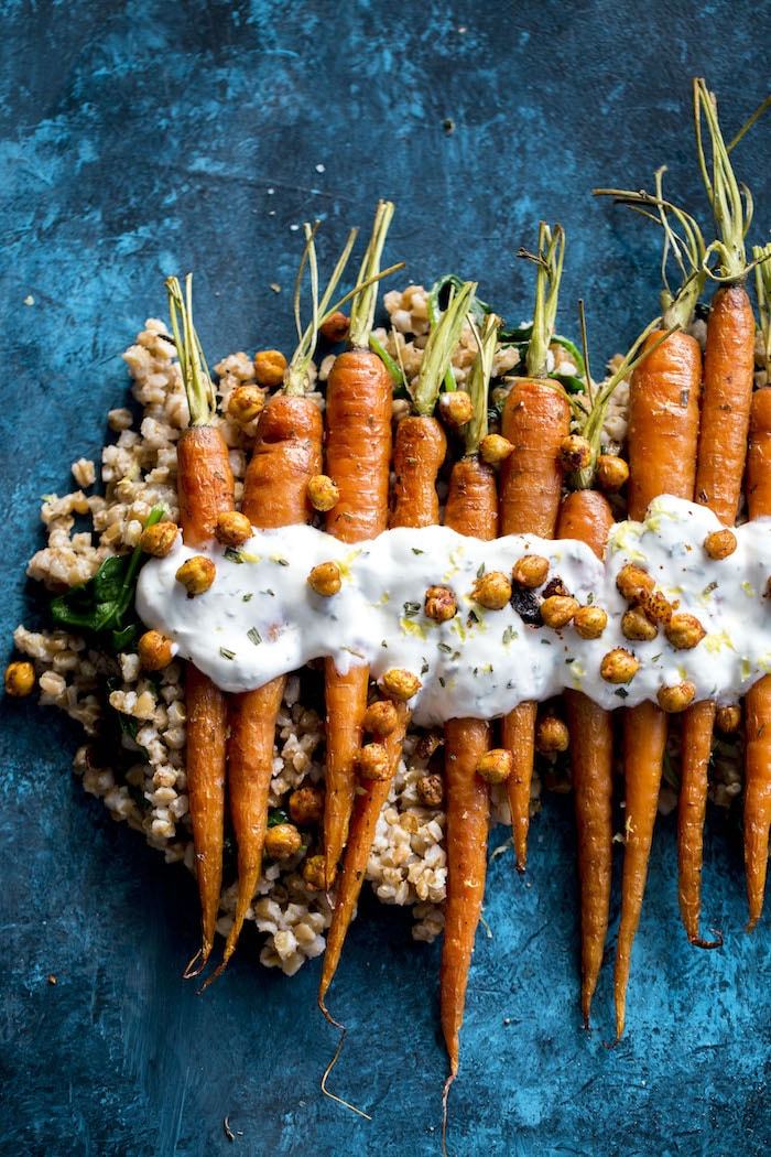 Roasted Carrots with farro, crunchy roasted chickpeas and a tangy lemon yogurt sauce!