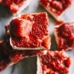 Cheesecake bars that taste just like cheesecake and are topped with a tasty strawberry chia seed compote! | thealmondeater.com