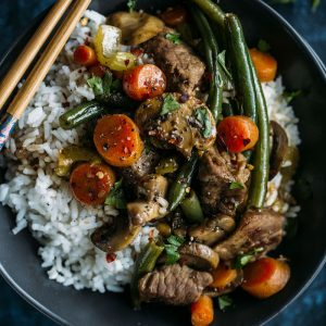 Beef Stir Fry made with beef, vegetables, rice, and soy sauce, aka a flavorful and well balanced meal
