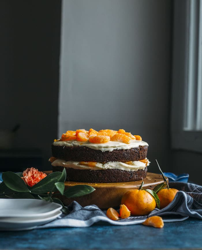 A VEGAN chocolate cake topped with tequila orange icing and tequila-soaked, sugar coated oranges, aka the perfect party cake!