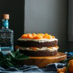 A chocolate cake topped with tequila orange icing and tequila-soaked, sugar coated oranges. The perfect party cake!!