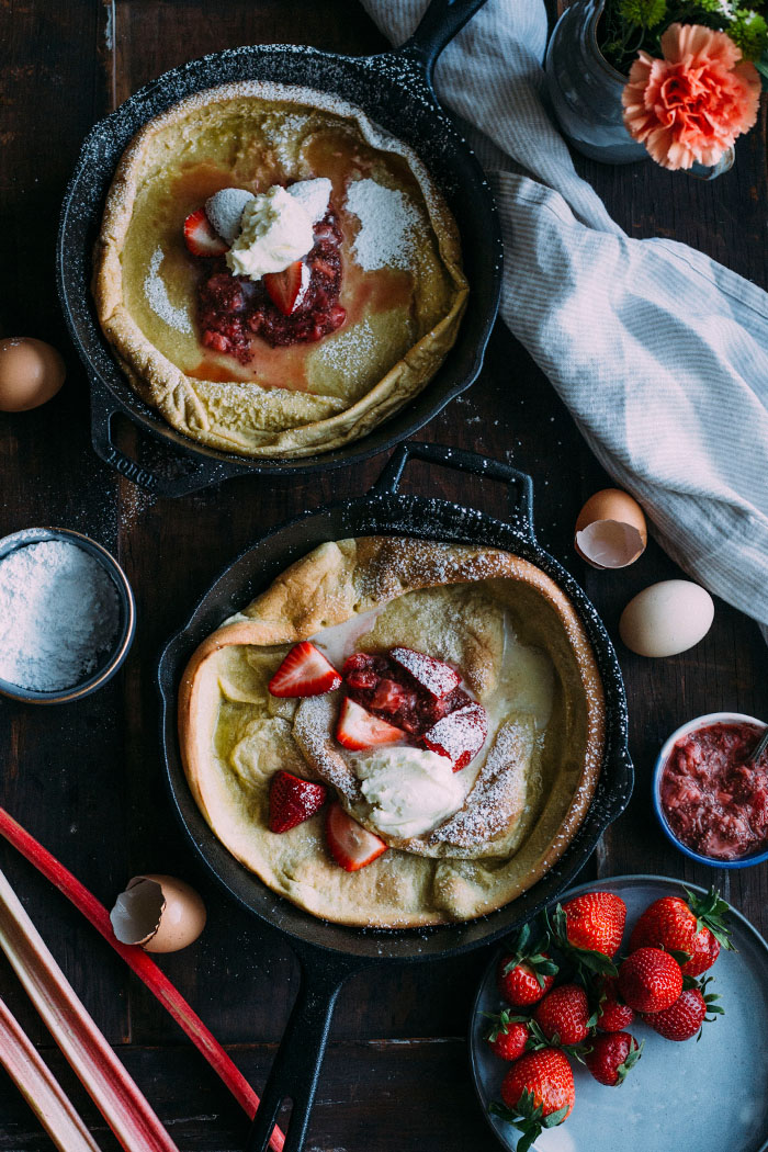 A delicious dutch baby pancake topped with strawberry rhubarb CHIA SEED compote and whipped mascarpone   thealmondeater.com