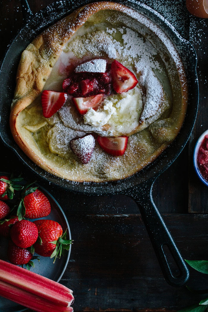 A simple dutch baby pancake topped with a strawberry rhubarb compote and whipped mascarpone   thealmondeater.com