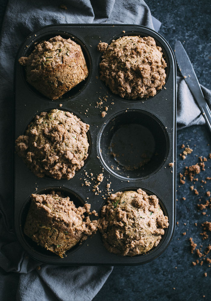 Whole wheat zucchini muffins made lighter and topped with a cinnamon crumble   thealmondeater.com