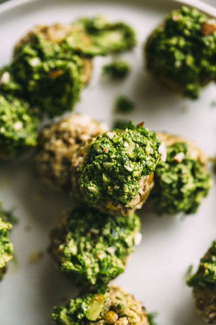 Lentil Meatballs topped with almond pesto--vegan and gluten free, they're a tasty meatless meal!