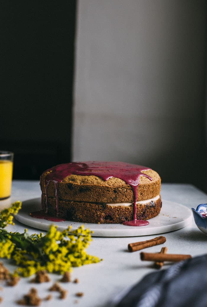 A lighter blueberry BRUNCH CAKE that's made with gluten free oat flour and topped with a yogurt-based icing! | thealmondeater.com