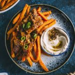 loaded sweet potato fries topped with honey ginger pork+caramelized onion dipping sauce!