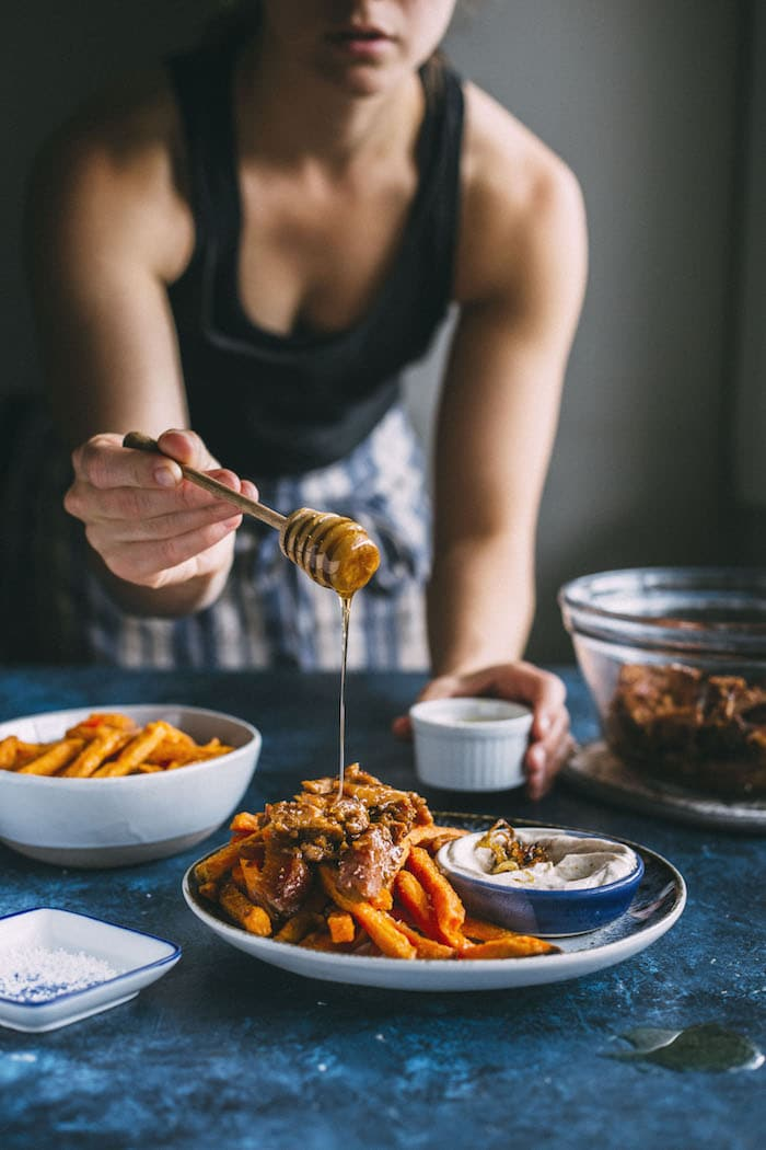 loaded sweet potato fries topped with pork+caramelized onion dipping sauce