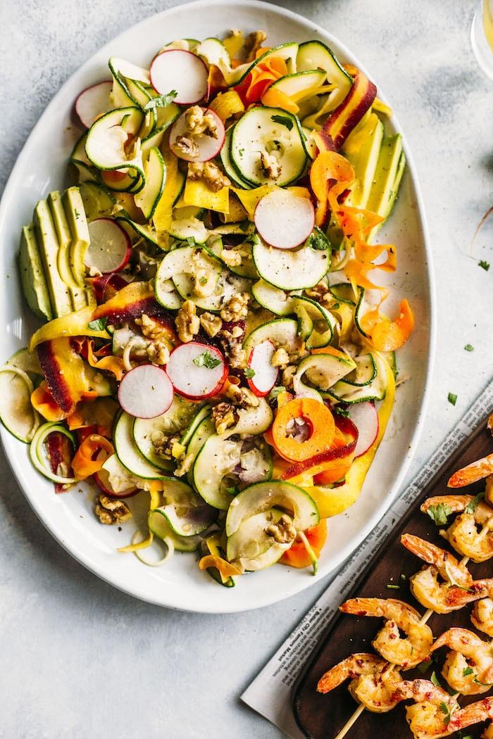 PALEO spiralized vegetable salad with garlic and lemon shrimp skewers!