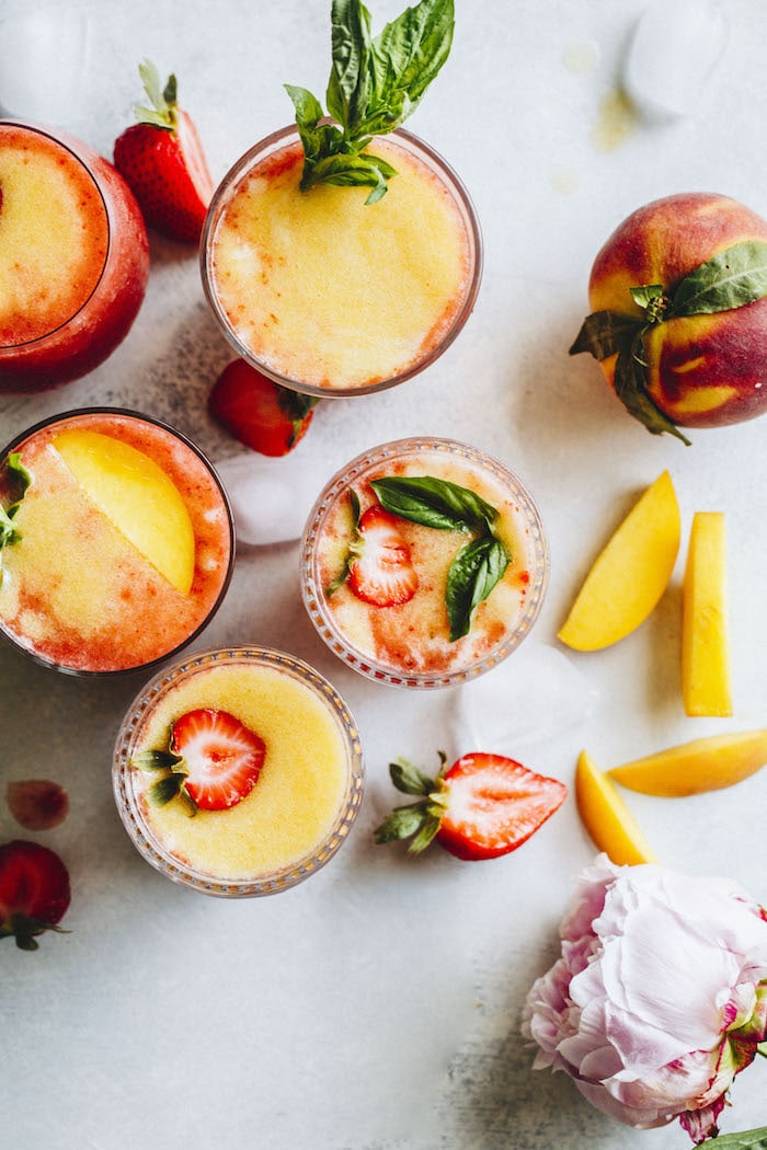 Strawberry Peach Slushies that combine wine and tequila for a boozy summery cocktail!