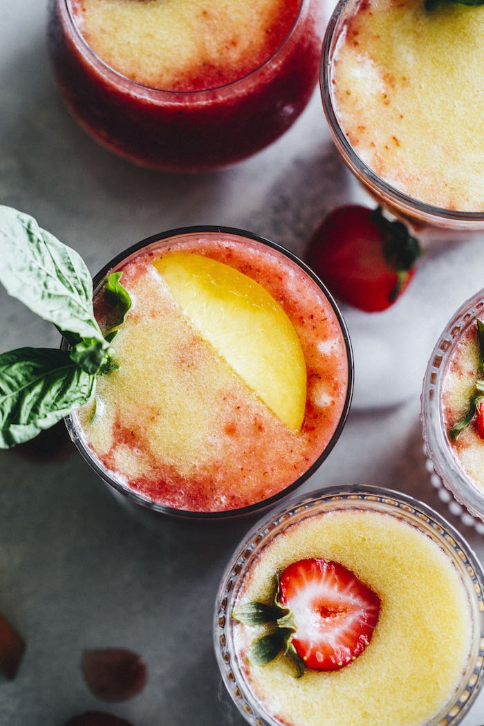 Tasty Strawberry Peach Slushies that combine wine and tequila for a fruity boozy cocktail!