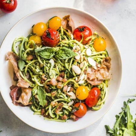 Arugula Pesto Zucchini Noodle Bowl with tomatoes and prosciutto--whole30 compliant, too!