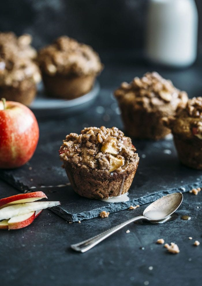 Whole Wheat Caramel Apple Muffins with a crumb topping | thealmondeater.com