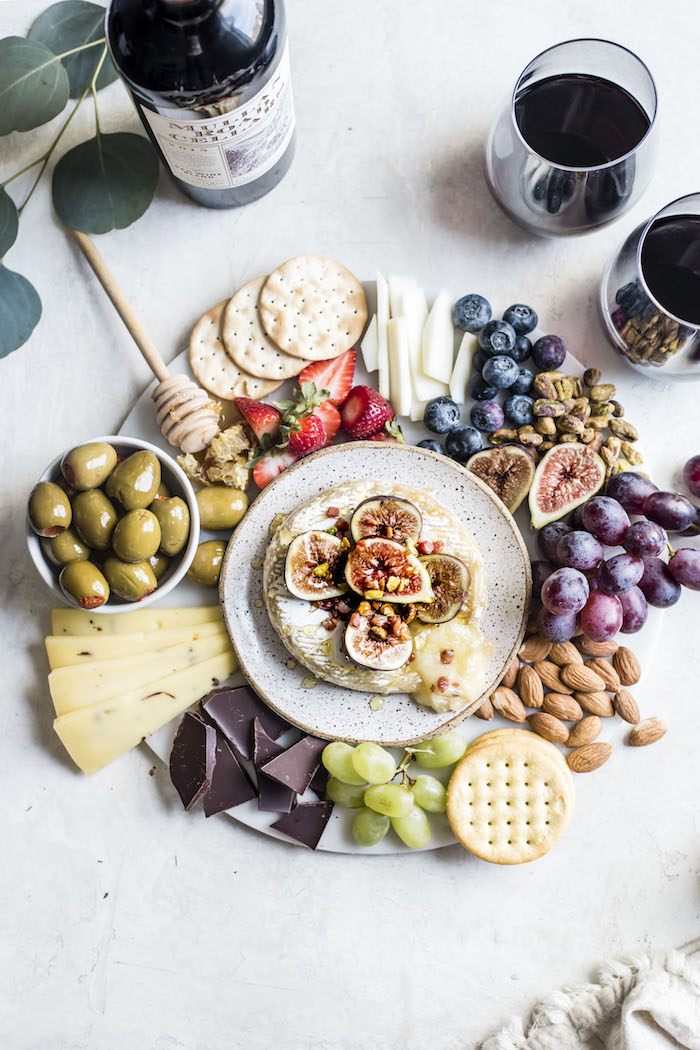 Summer Cheese Board Necessities, including a delicious baked brie topped with figs, pancetta and pistachios | thealmondeater.com