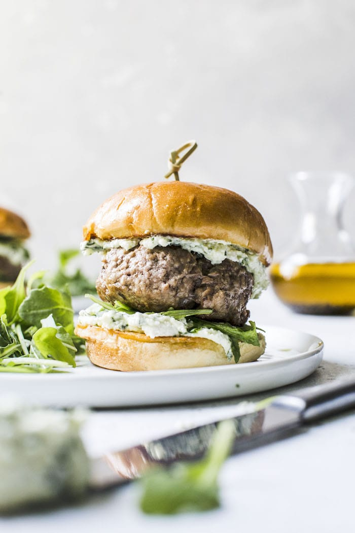 Lamb Burgers with PESTO Whipped Feta, aka your new favorite burger topping | thealmondeater.com