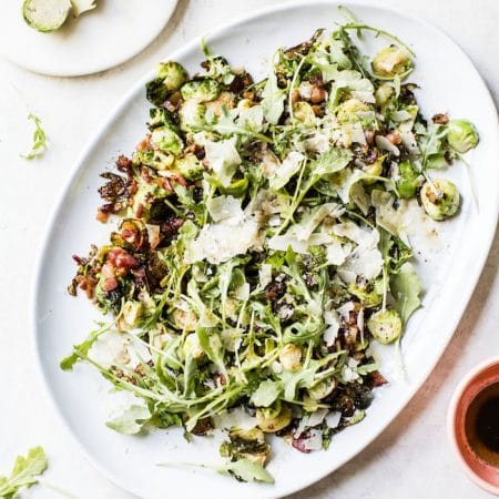 Brown Butter Brussels Sprouts Salad | brussels sprouts, pancetta & arugula drizzled with a balsamic brown butter dressing | thealmondeater.com