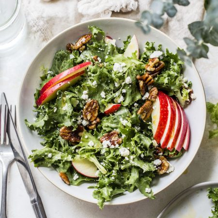 Candied Pecan Frisée Salad topped with apples, goat cheese and a little brown butter | thealmondeater.com