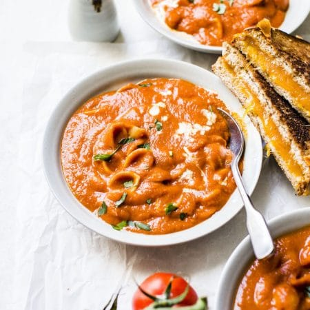 One Pot Tomato Soup made with gluten free pasta and harissa for added spice!   thealmondeater.com