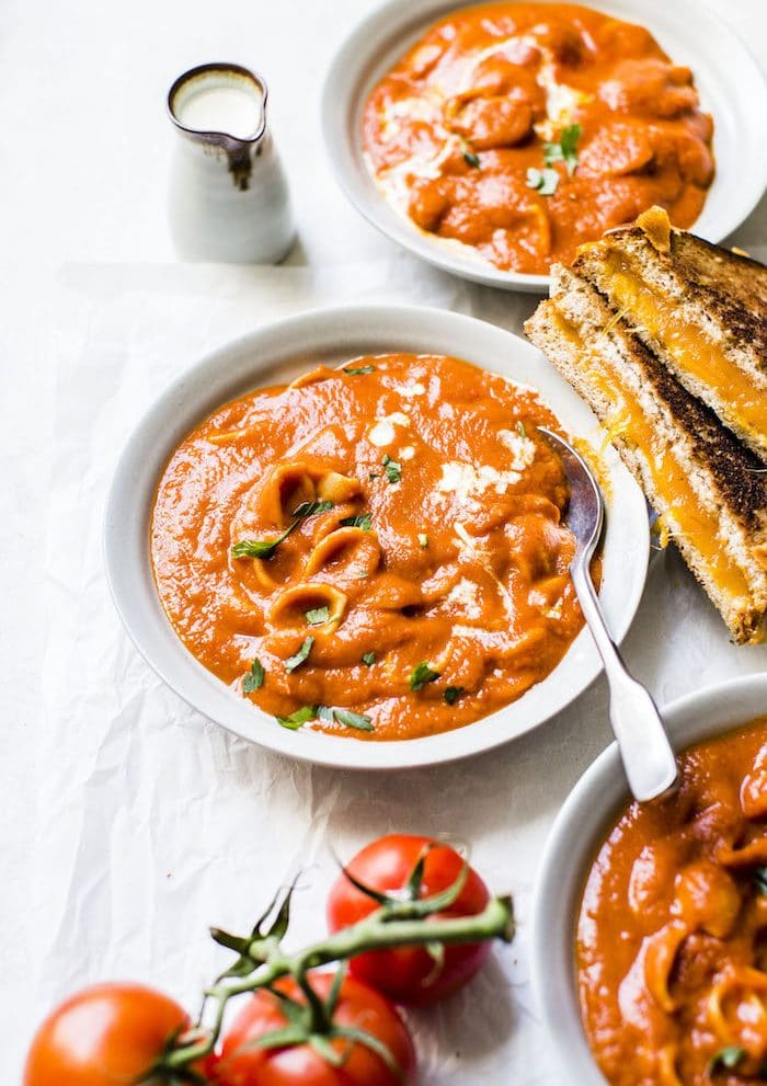 One Pot Tomato Soup made with gluten free pasta and harissa for added spice! | thealmondeater.com