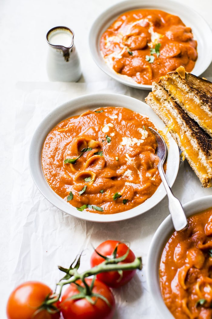 One Pot Tomato Soup made with gluten free pasta and harissa for added spice! | #vegan #glutenfree | thealmondeater.com