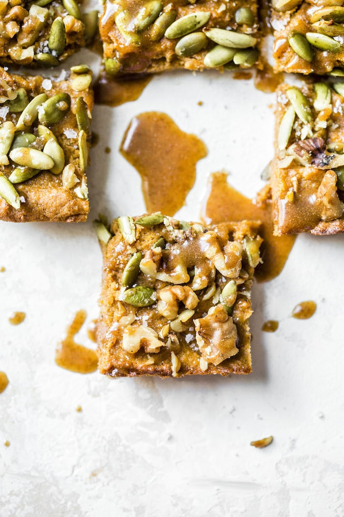 Paleo Sweet Potato Bars made with mashed sweet potato, almond flour and topped with a sweet maple almond glaze #paleo   thealmondeater.com