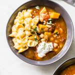 Butternut Squash Chickpea Chili - a tasty vegan-friendly chili recipe made in the slow cooker and topped with mac and cheese! | thealmondeater.com