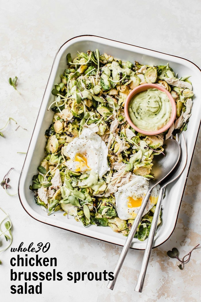Chicken Brussels Sprouts Salad served with poached eggs and an avocado dressing #whole30 | thealmondeater.com