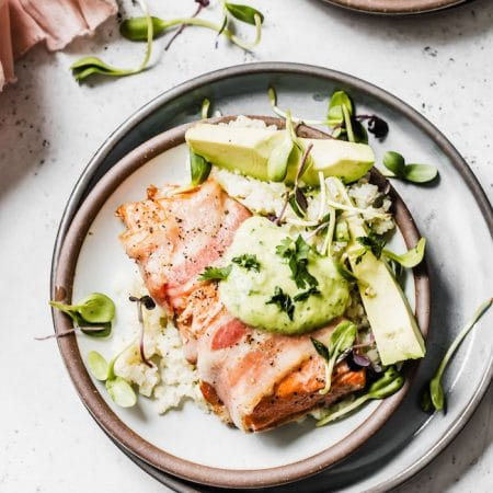 Paleo Bacon-Wrapped Salmon with cauliflower rice and avocado dressing #paleo | thealmondeater.com