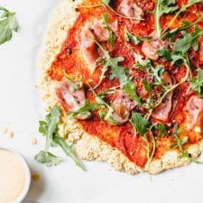 Whole30 pizza recipe made with cauliflower crust and your choice of toppings! #whole30 | thealmondeater.com