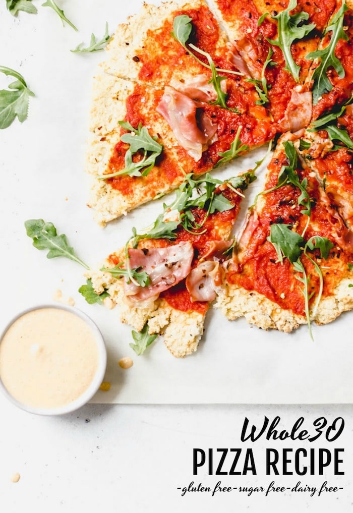Whole30 Pizza Recipe - pizza made with cauliflower crust and topped with simple ingredients for you on your whole30! | thealmondeater.com
