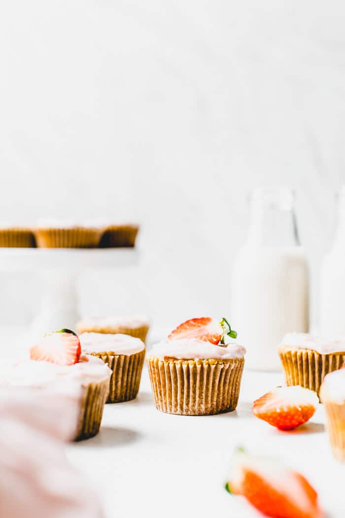 Gluten Free Strawberry Vanilla Cupcakes - vanilla cupcakes made with almond flour and topped with strawberry icing | thealmondeater.com