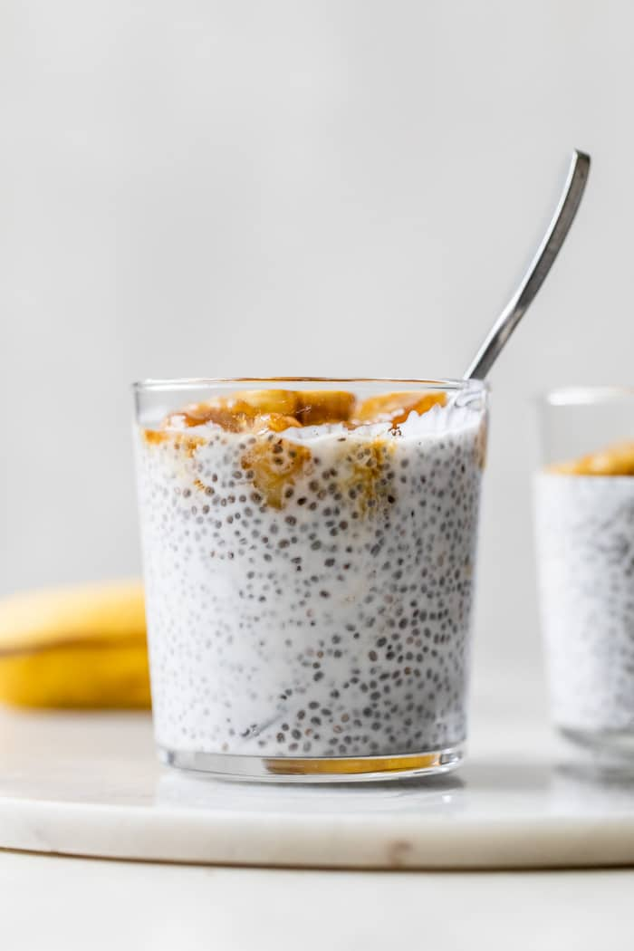 milk and chia seeds in a glass topped with bananas