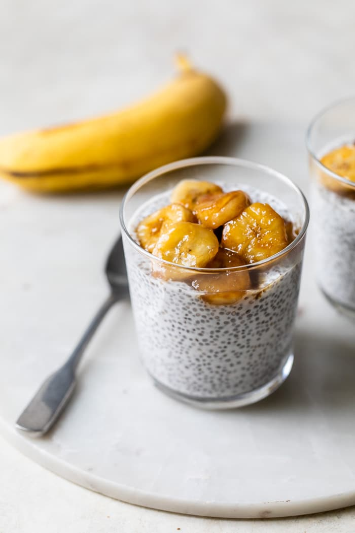 milk and chia seeds in a glass topped with banana