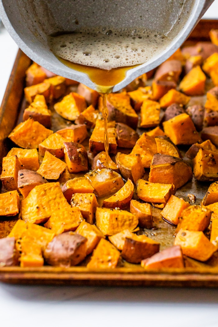 butter poured over roasted sweet potatoes