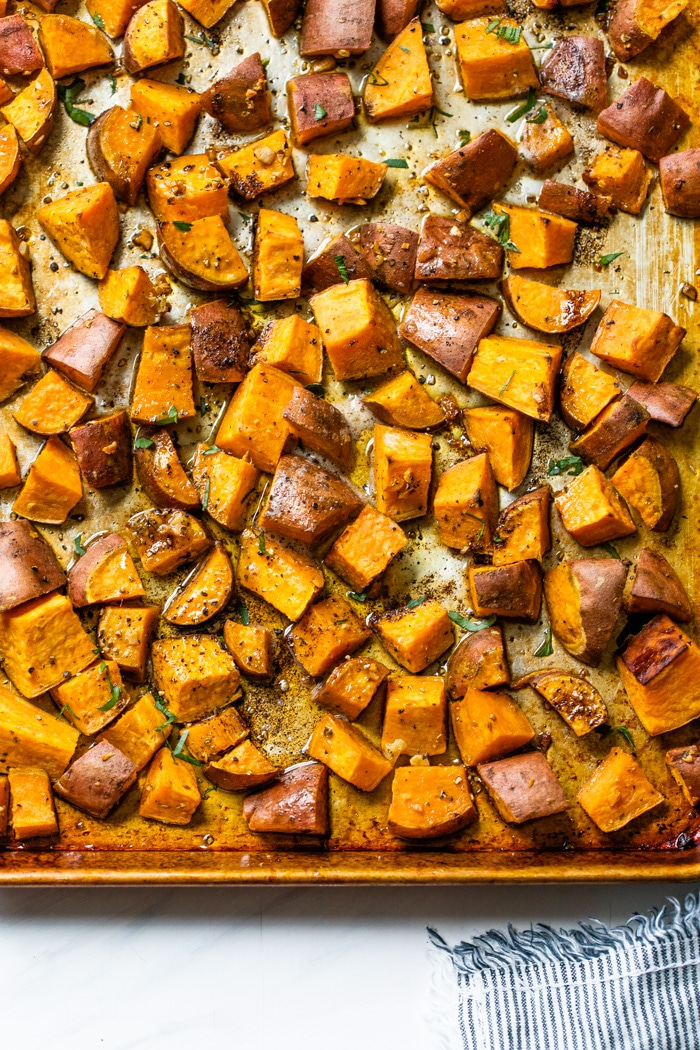 a baking sheet full of roasted sweet potatoes