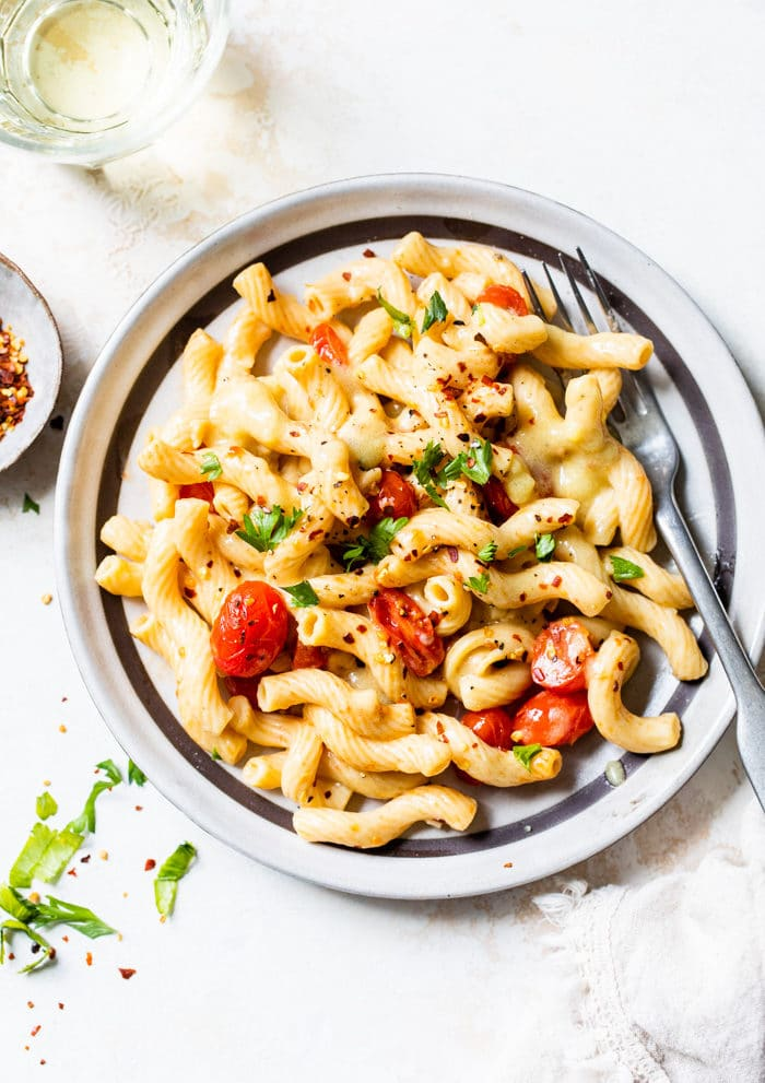 a plate of pasta with roasted tomatoes