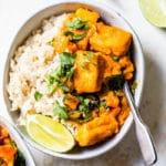 tofu coated in sauce over rice