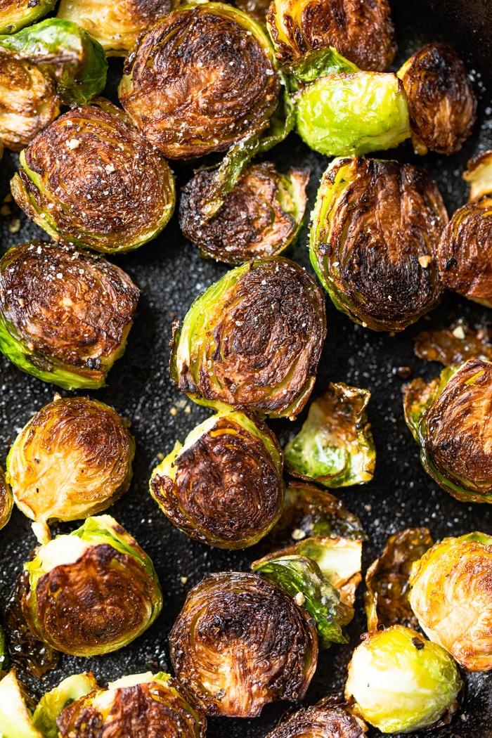 brussels sprouts fried in a skillet