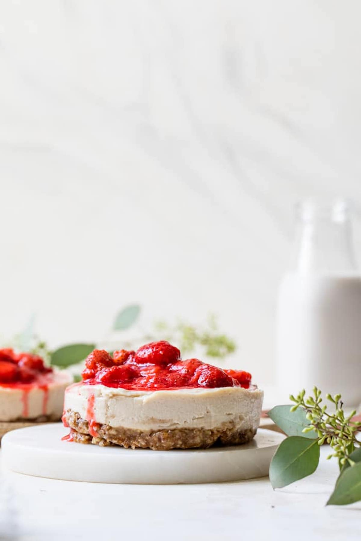 cashew cheesecake topped with strawberries