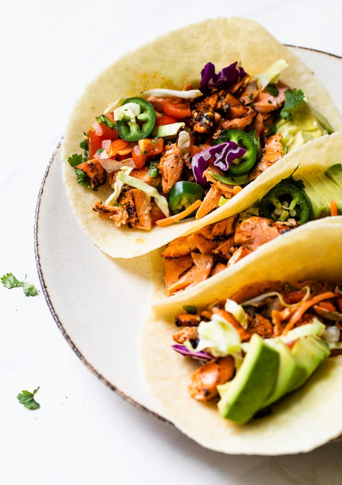 tacos filled with salmon, jalapeño and avocado