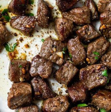 cut steak in a skillet