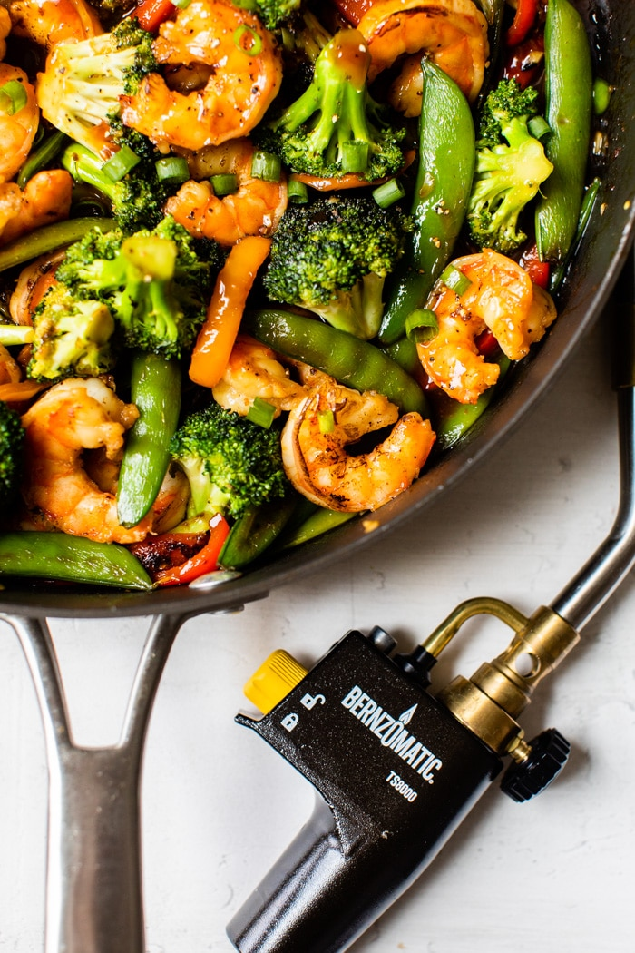 shrimp and vegetables in a skillet