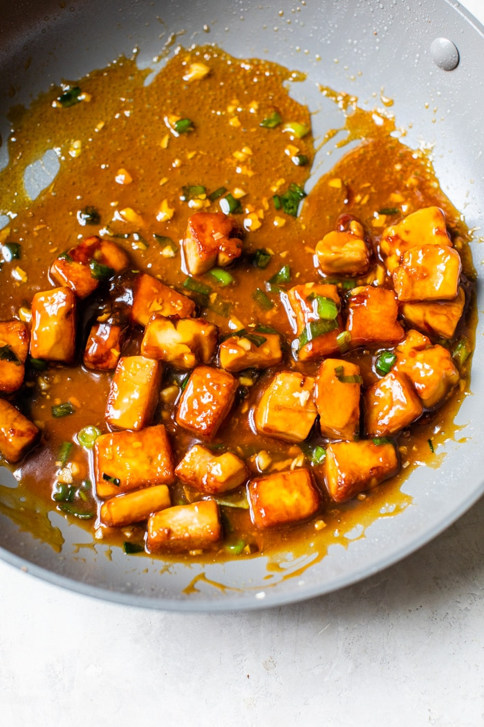 tofu in a skillet with Asian sauce