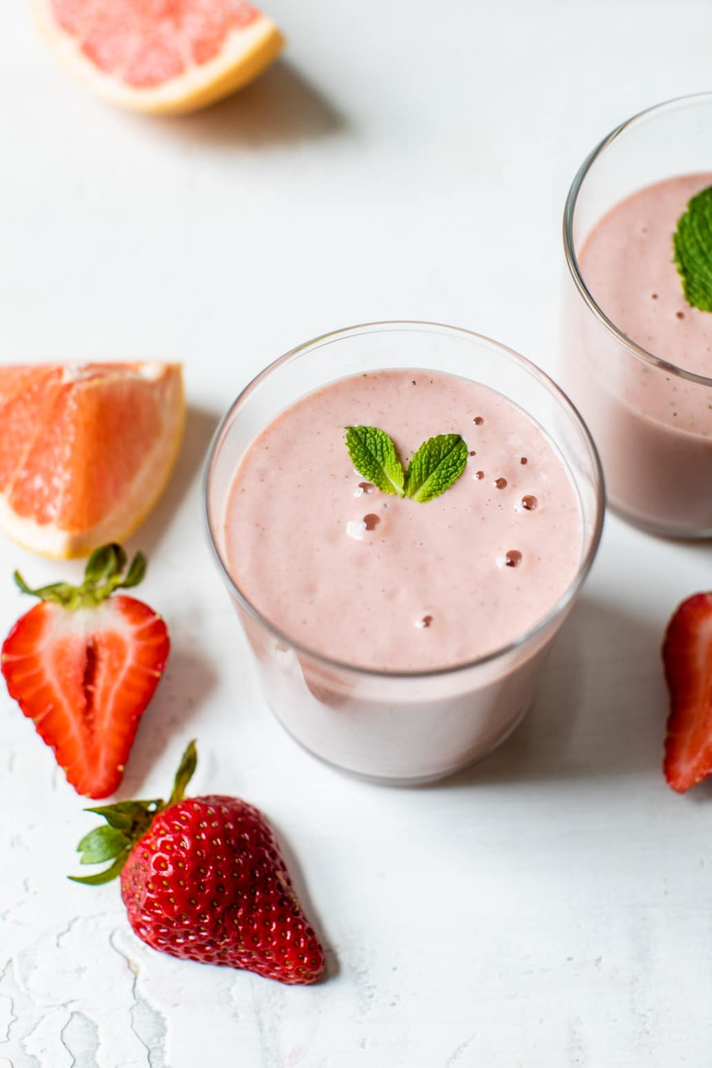 pink smoothie topped with fresh mint